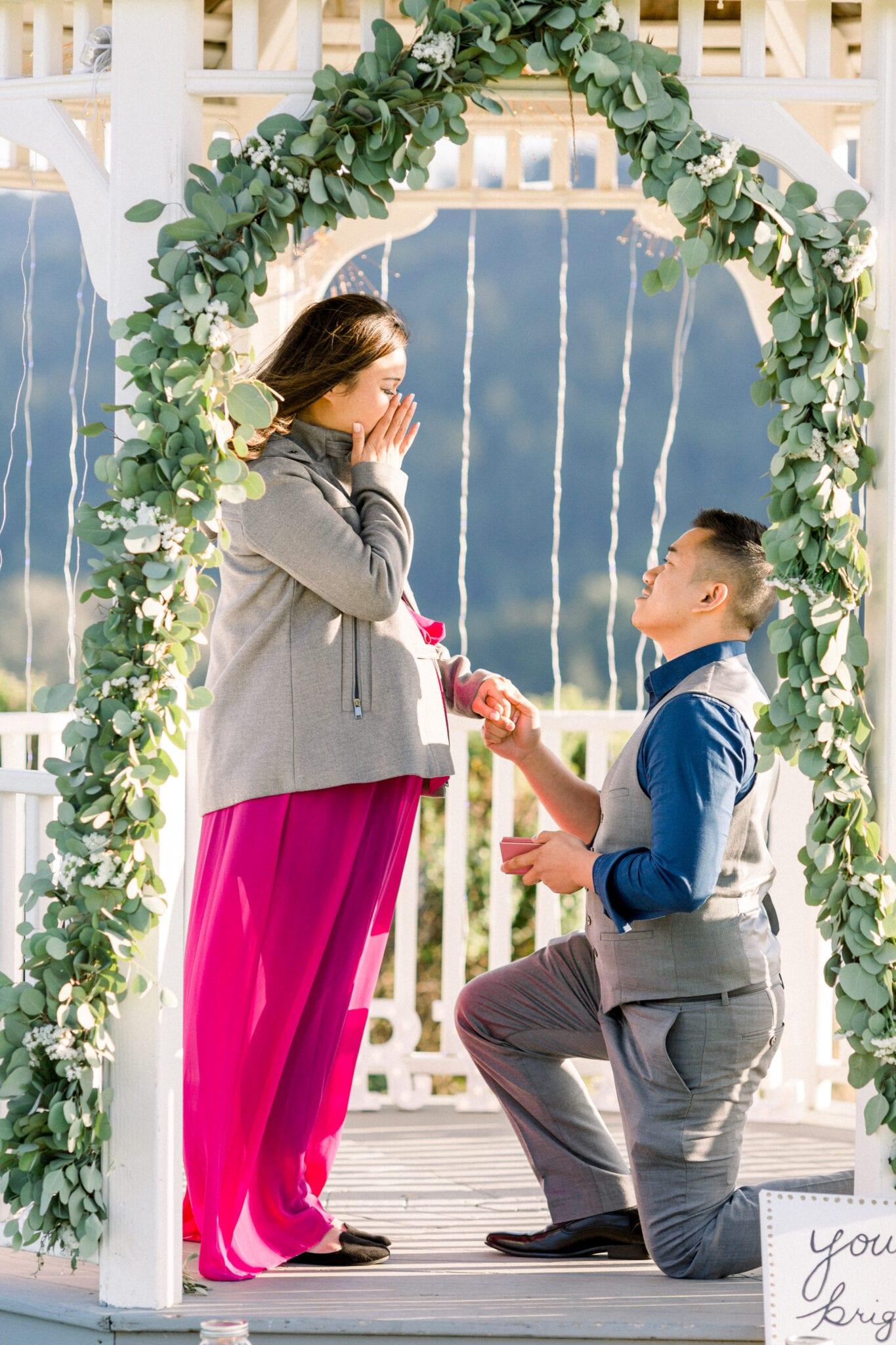 man proposing in gazebo