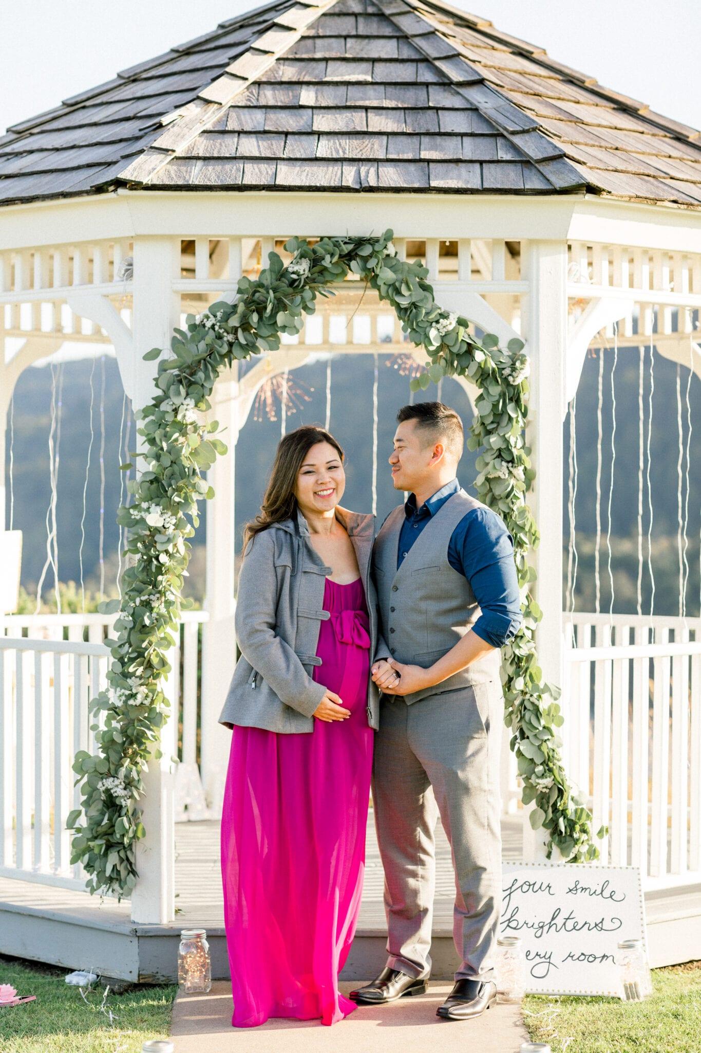 Pregnant couple in gazebo