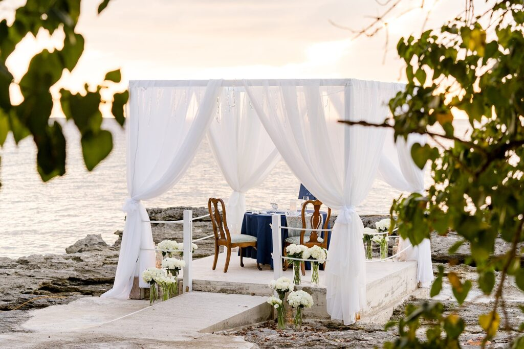 marriage proposal planners set up private beach proposal in grand caymans
