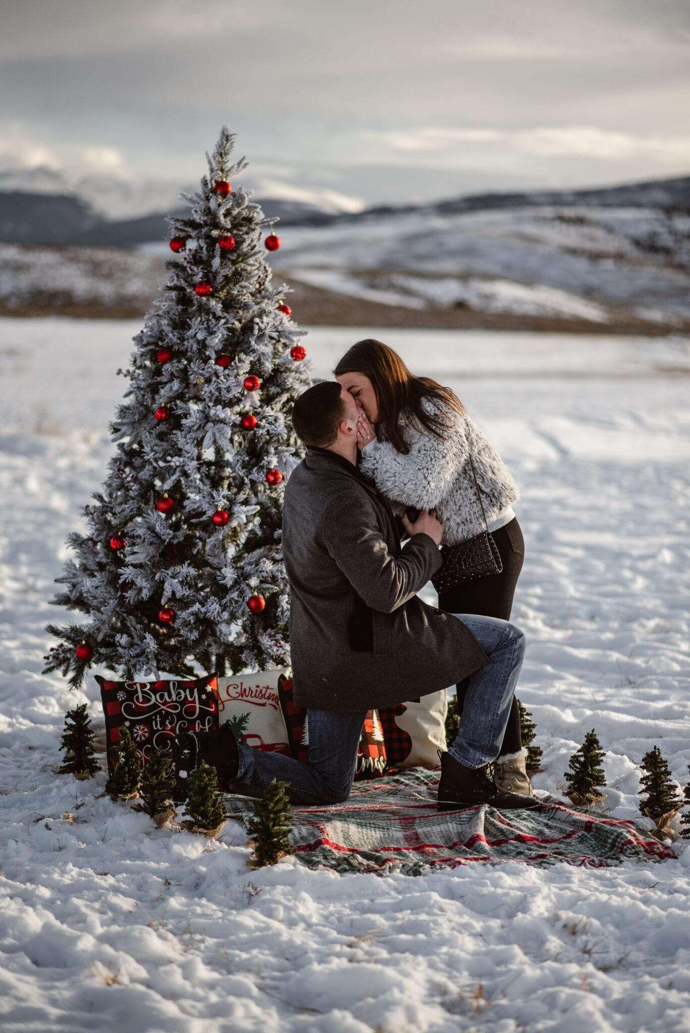 amazing holiday marriage proposal in Vail by the yes girls