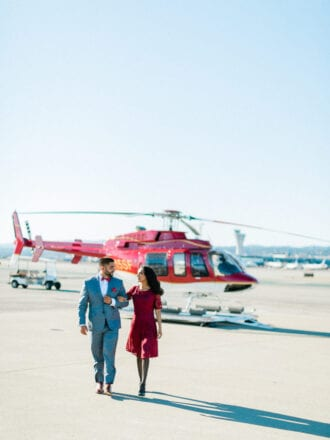 couple walking away from helicopter