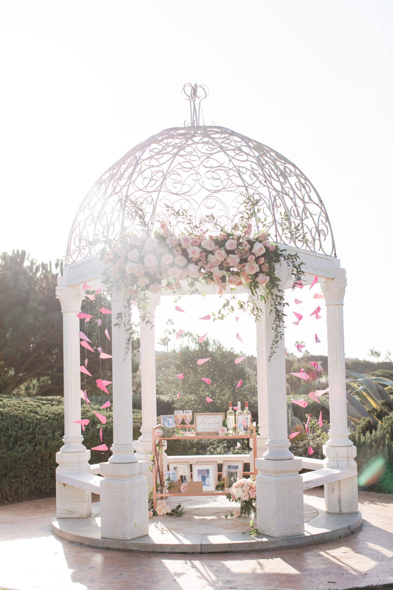 gazebo decorated in pink flowers