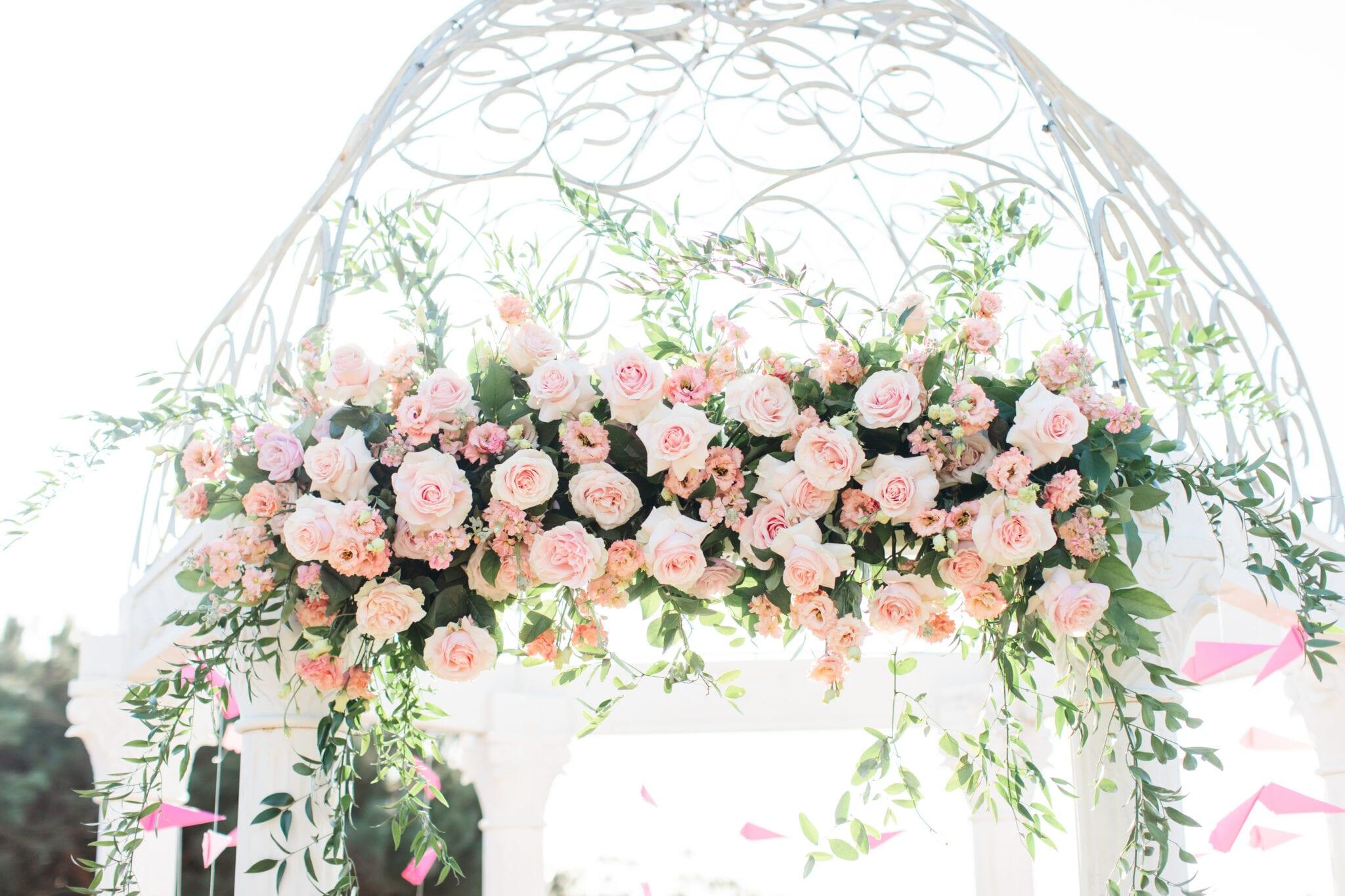 blush flowers on gazebo