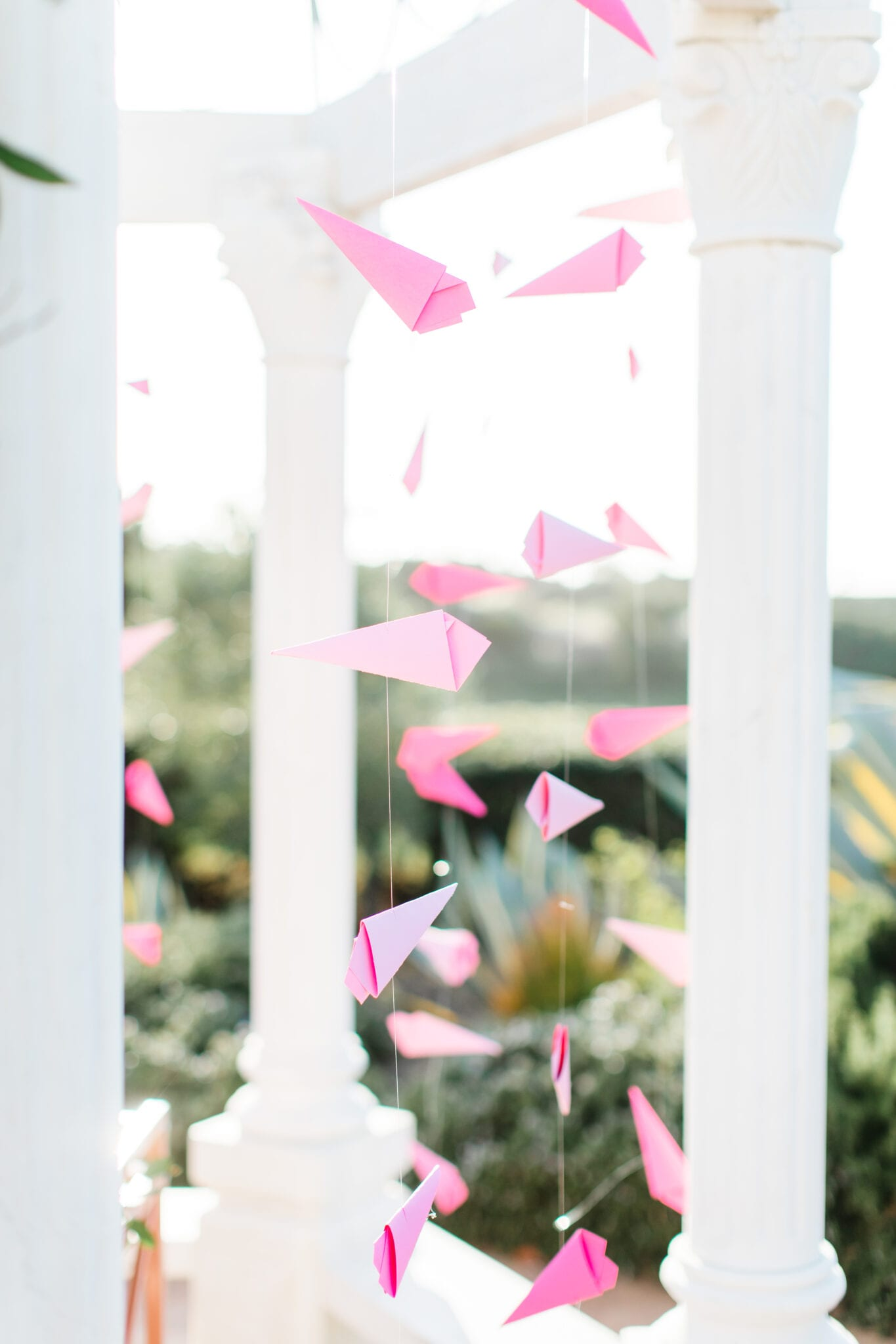pink paper airplanes