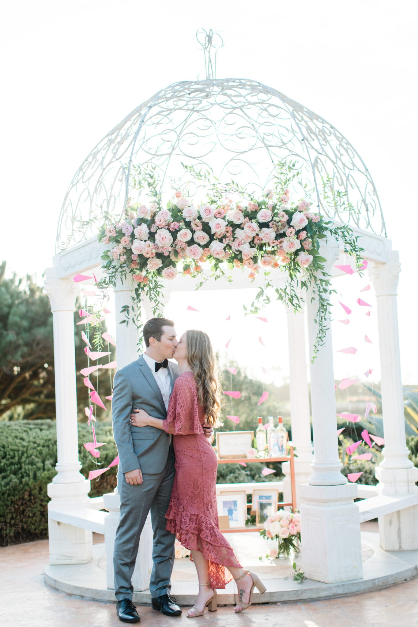 couple kissing in front of gazebo