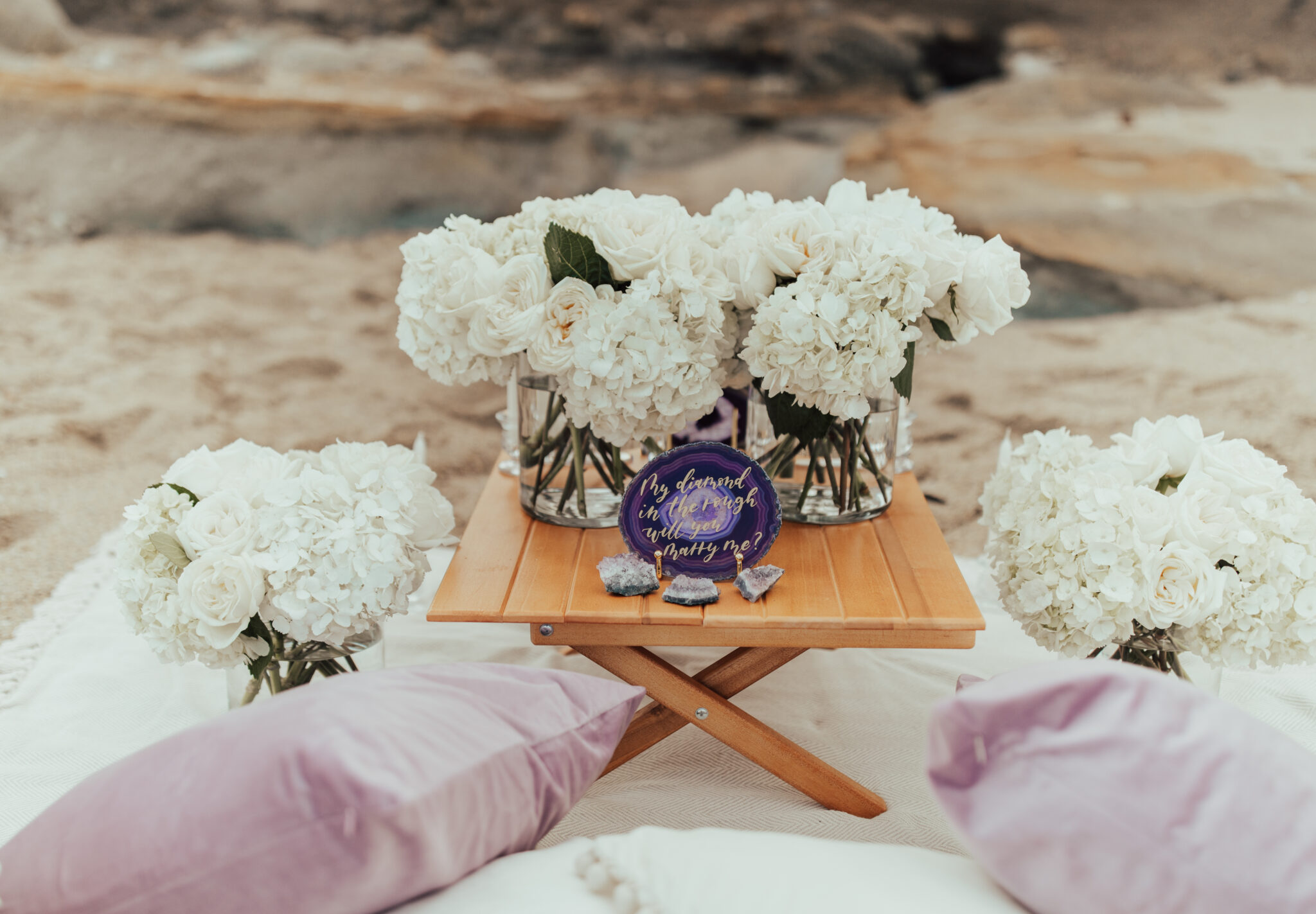 purple geode proposal at the beach