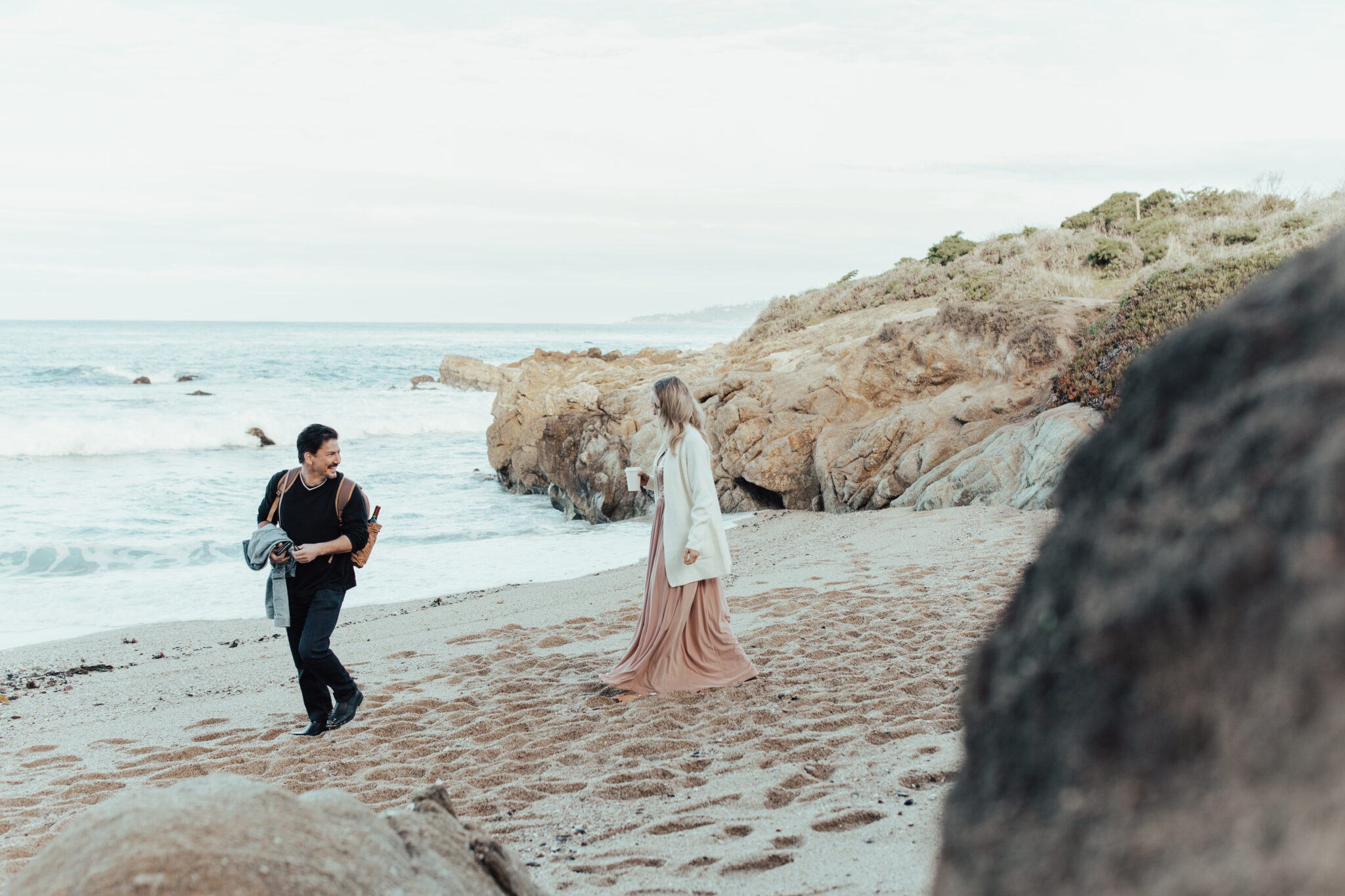 couple walking in sand