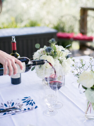 pouring wine for a winery marriage proposal