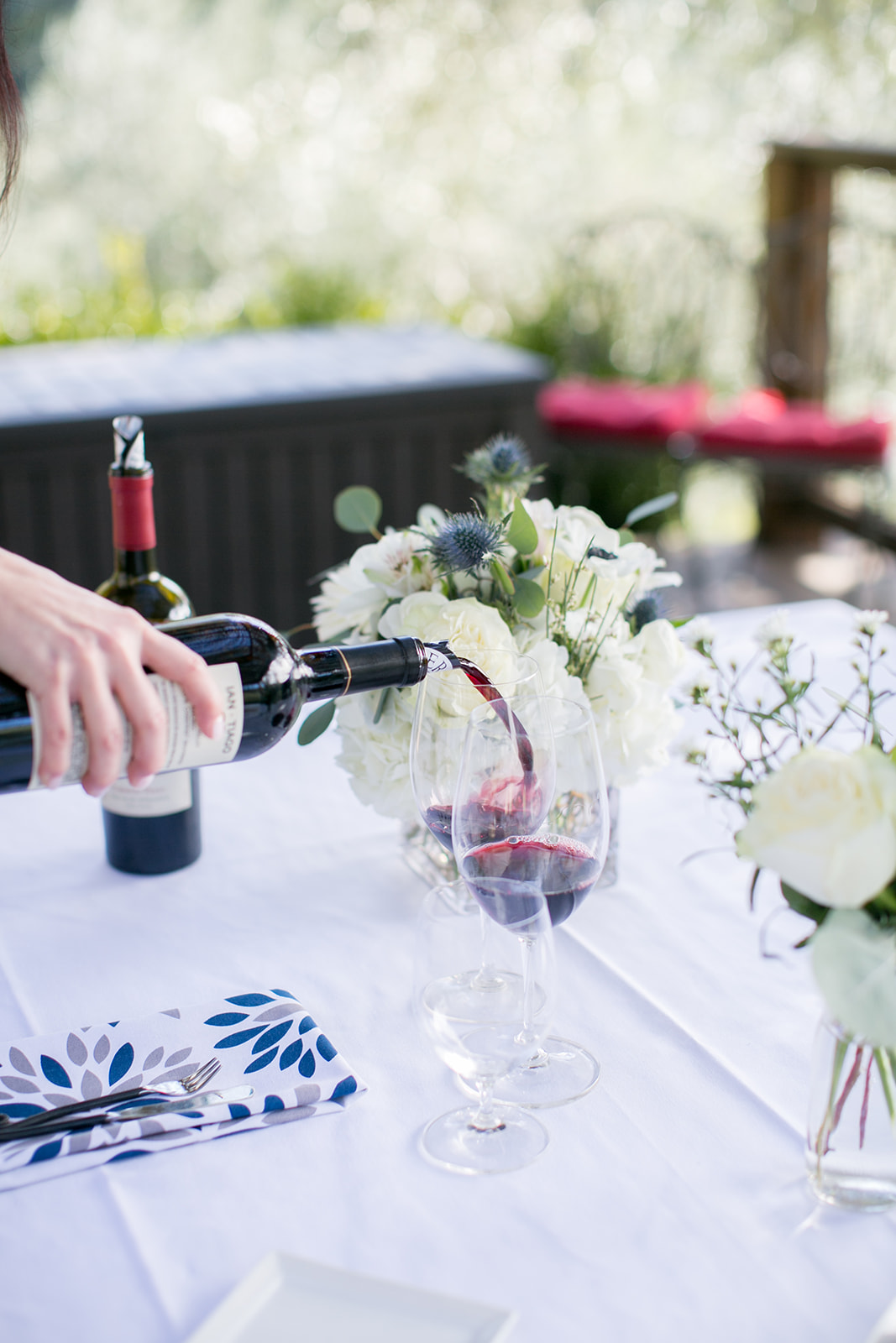 pouring wine at pretty table