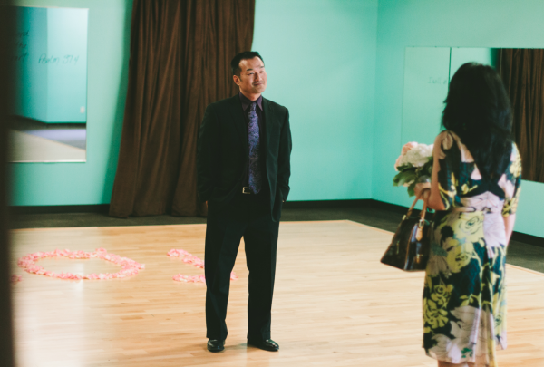 man waiting for woman in dance room