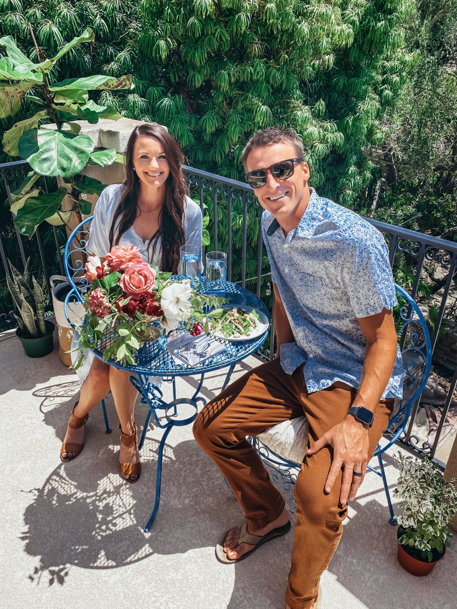 couple sitting at table on balcony
