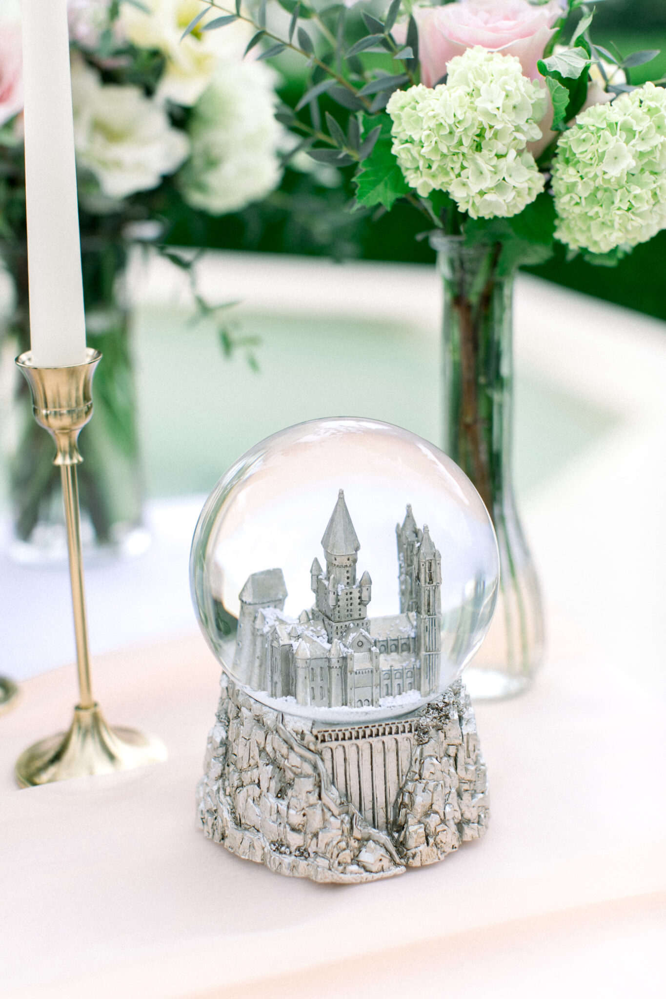 castle snow globe on romantic table
