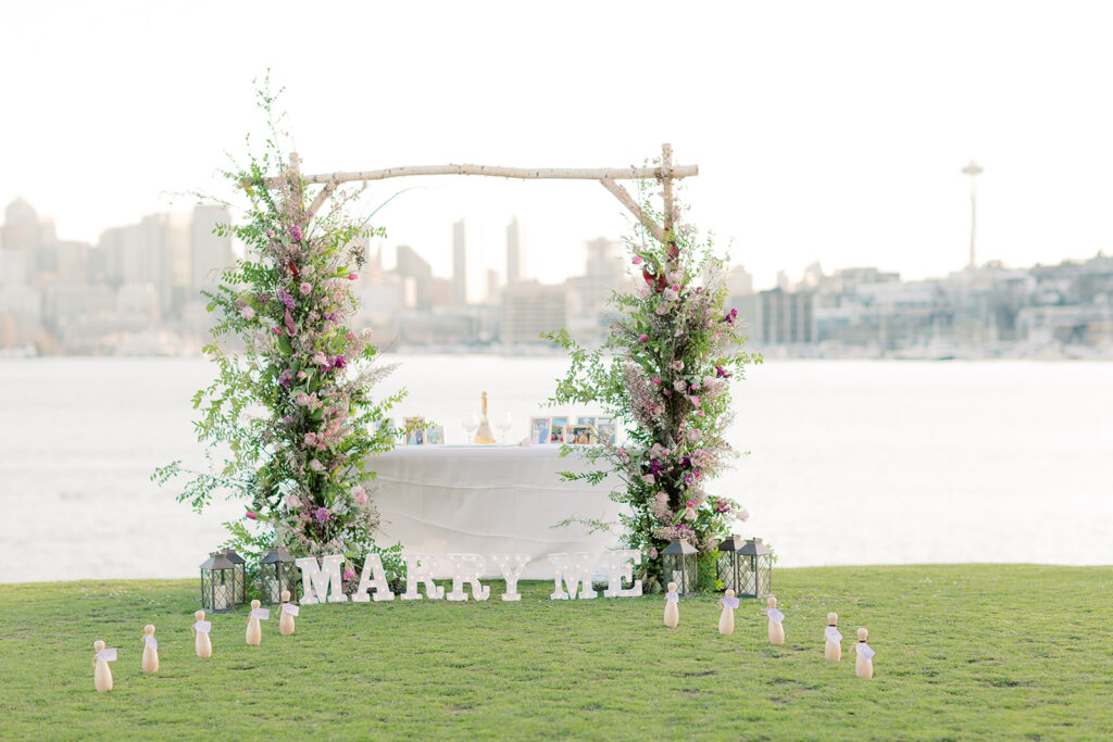 flower arch marry me sign