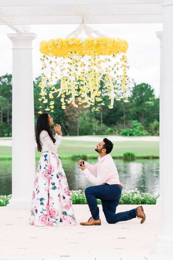 Man down on one knee floral chandelier