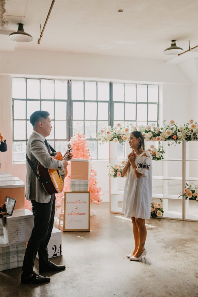 Client playing the guitar for his proposal