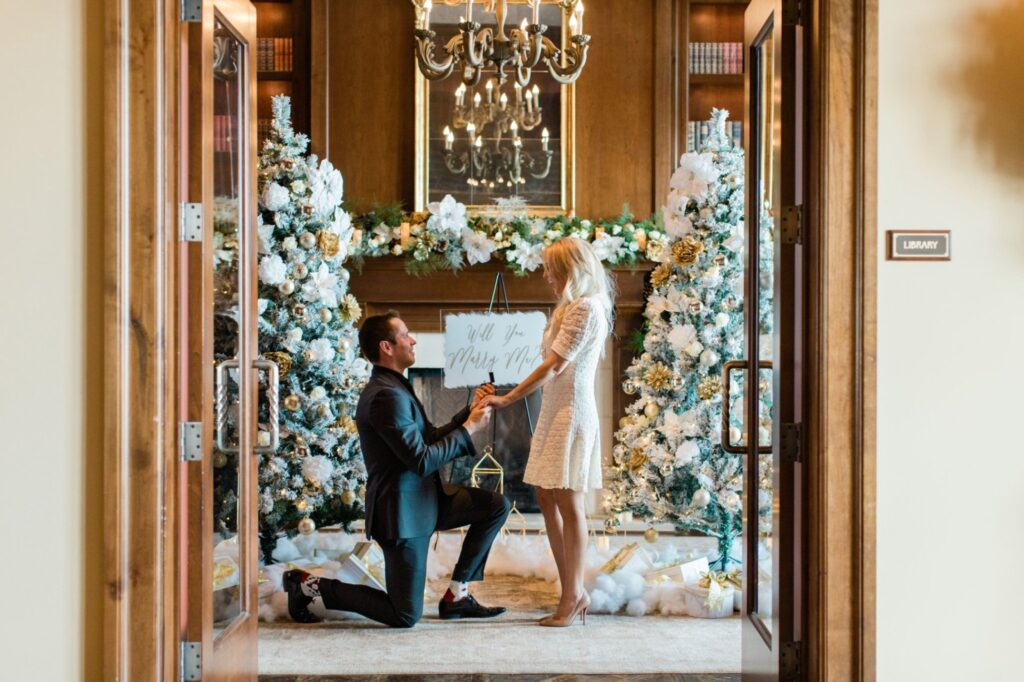man down on one knee christmas proposal
