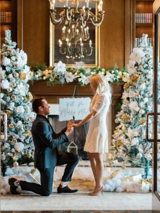 man down on one knee christmas proposal