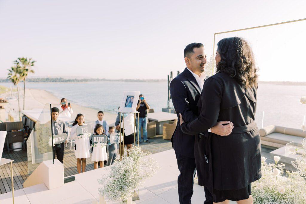 family celebrating marriage proposal