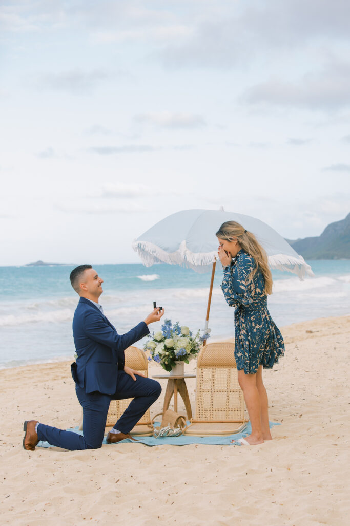 Man proposing to girlfriend on the beach in Hawaii