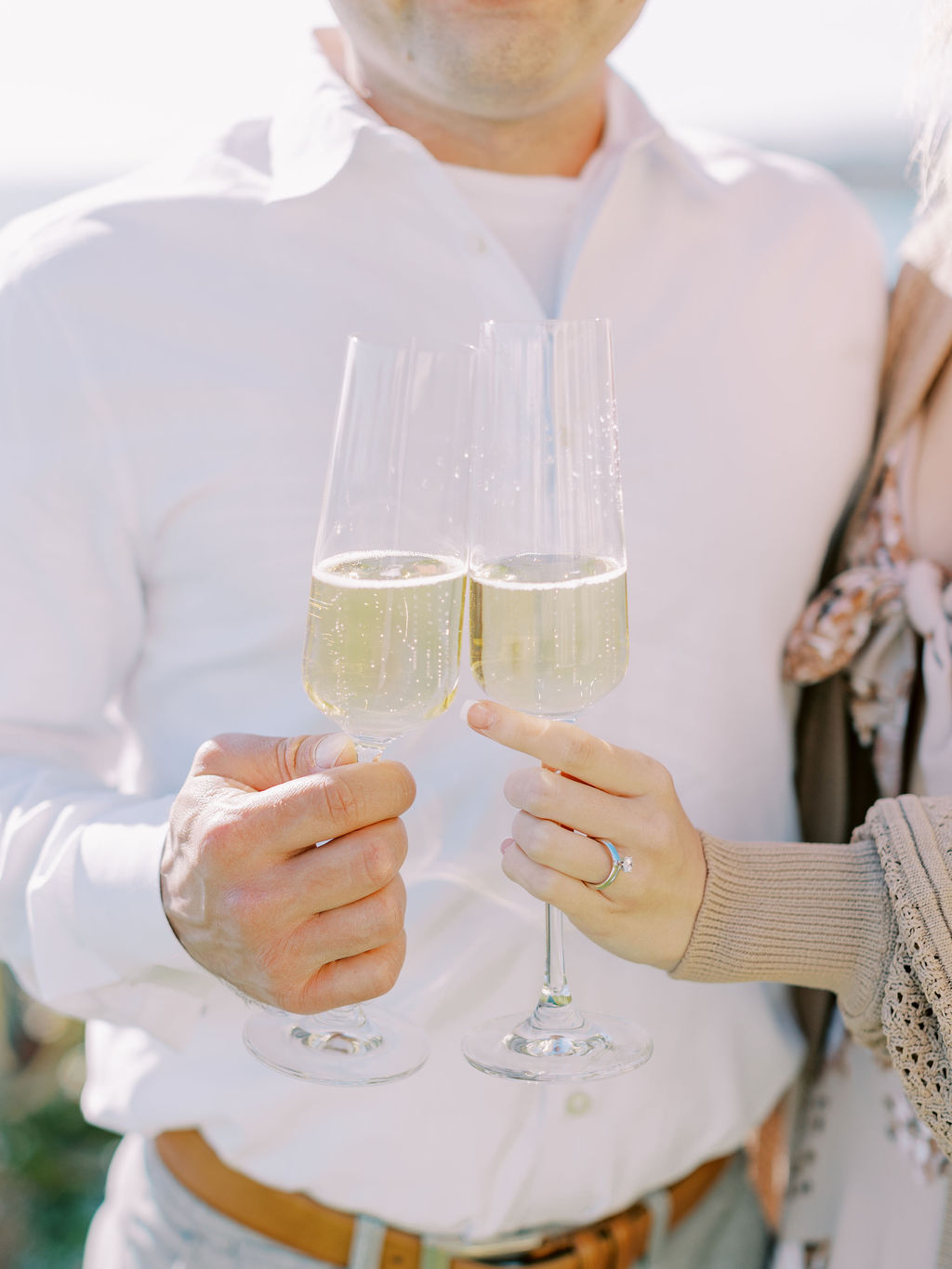 Couple cheering champagne