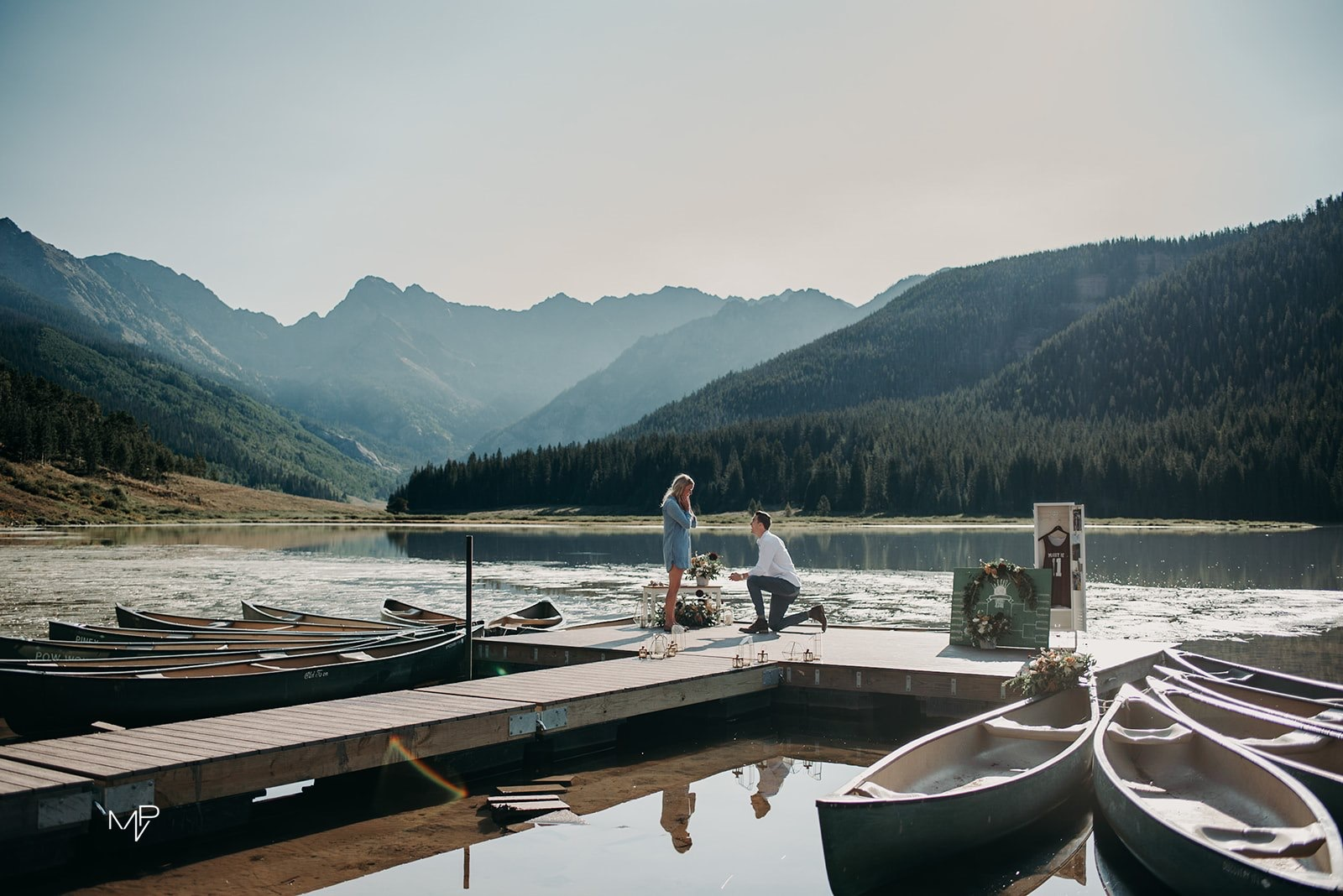 Couple getting engaged on lake