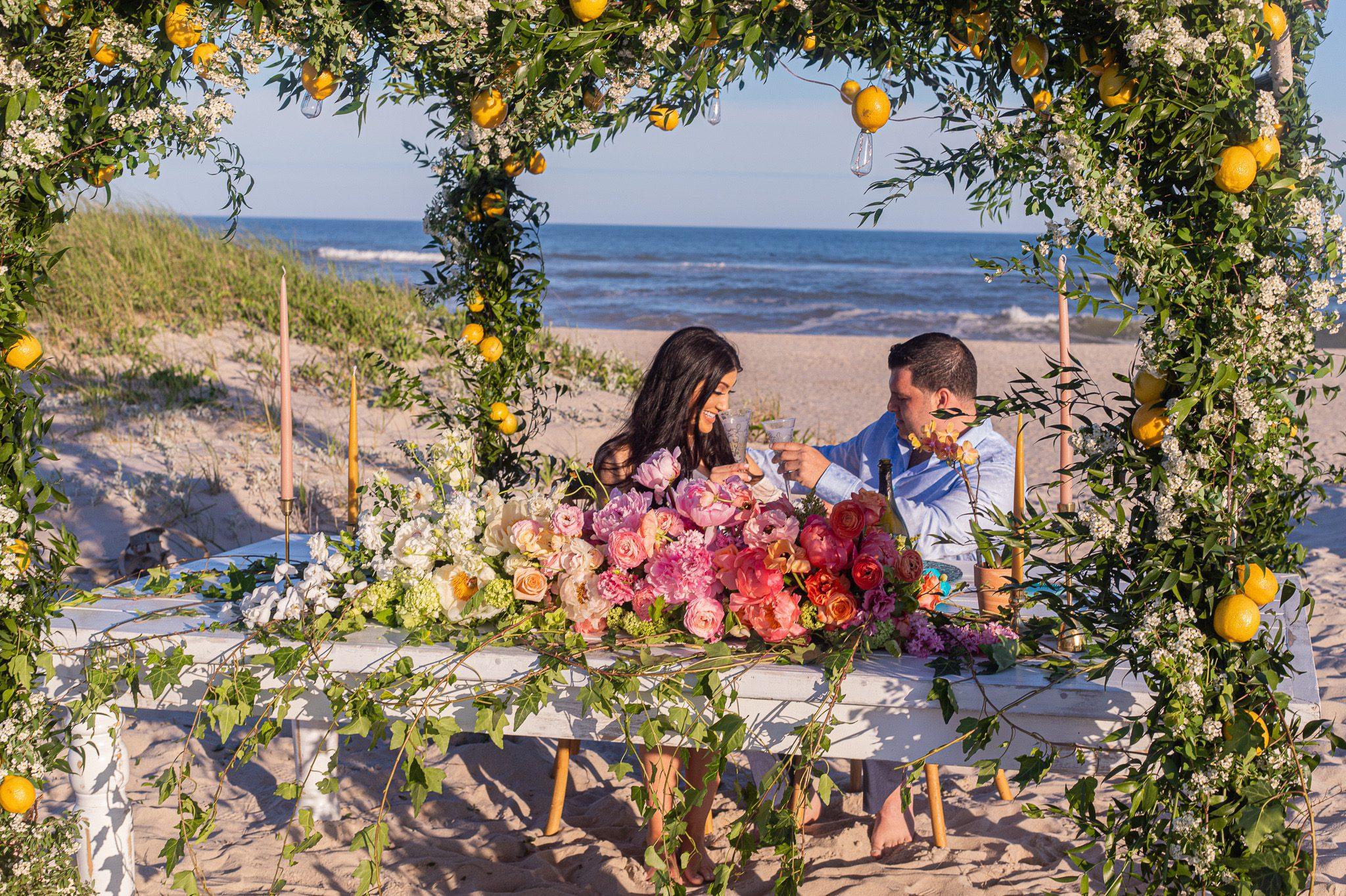 Couple celebrating proposal on gorgeous beach