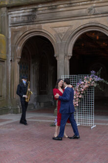Couple dancing in central park right after marriage proposal
