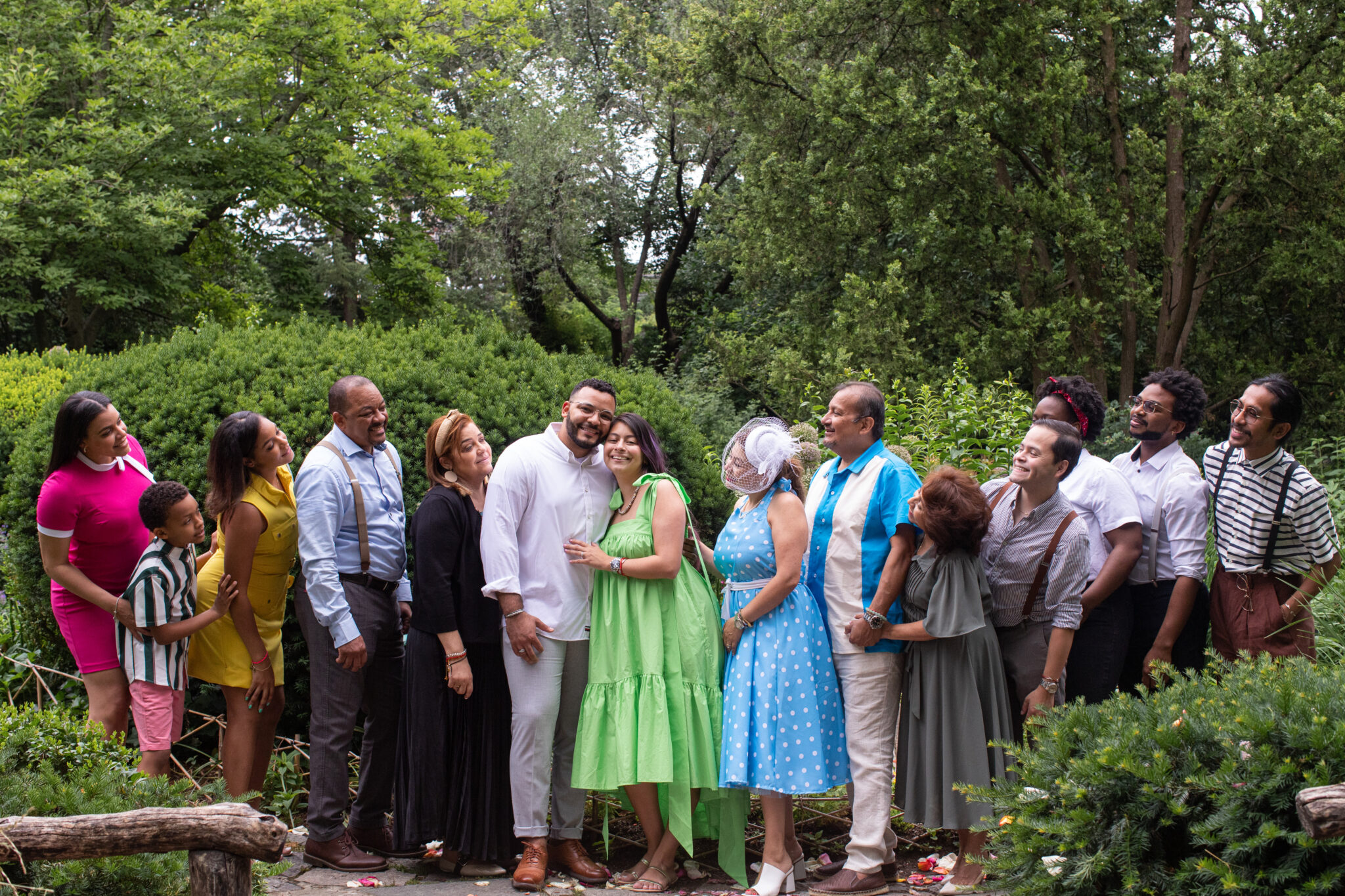 Family celebrating marriage proposal in central park