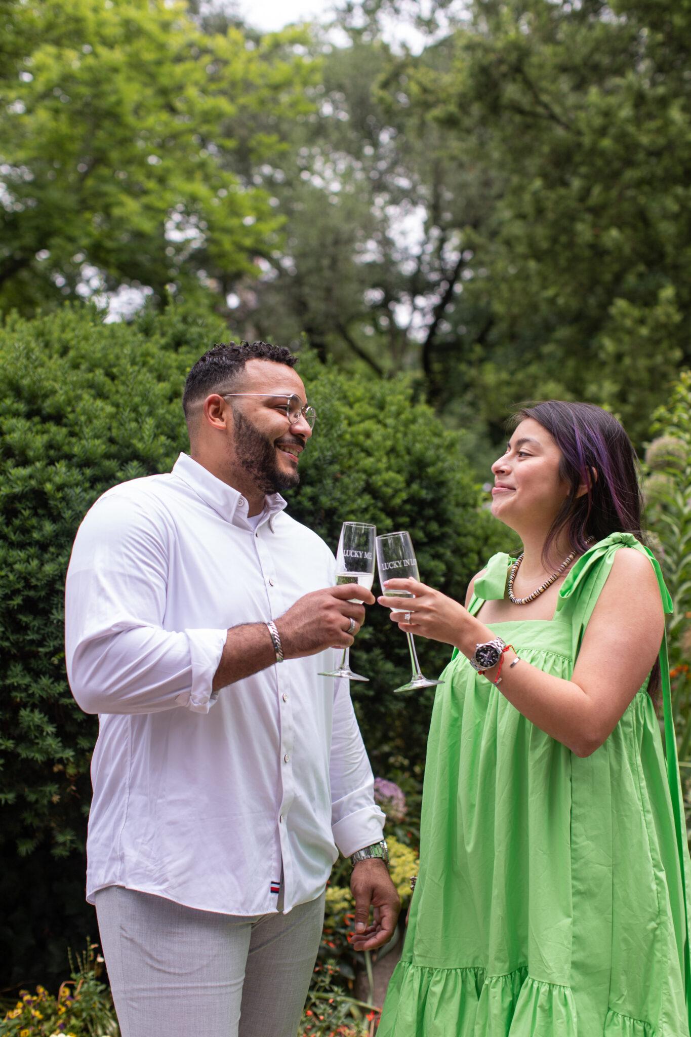 Newly engaged couple toasting champagne