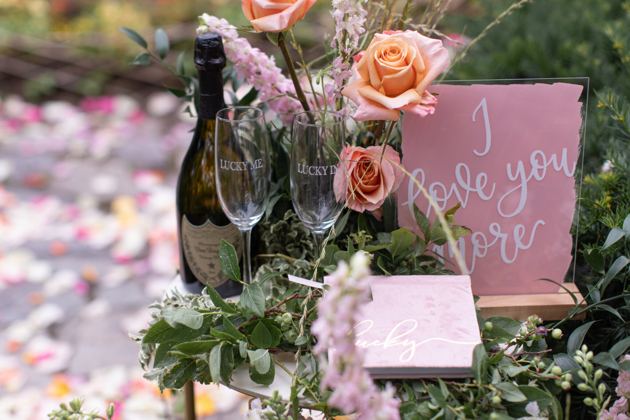 close up of wine and flowers for proposal