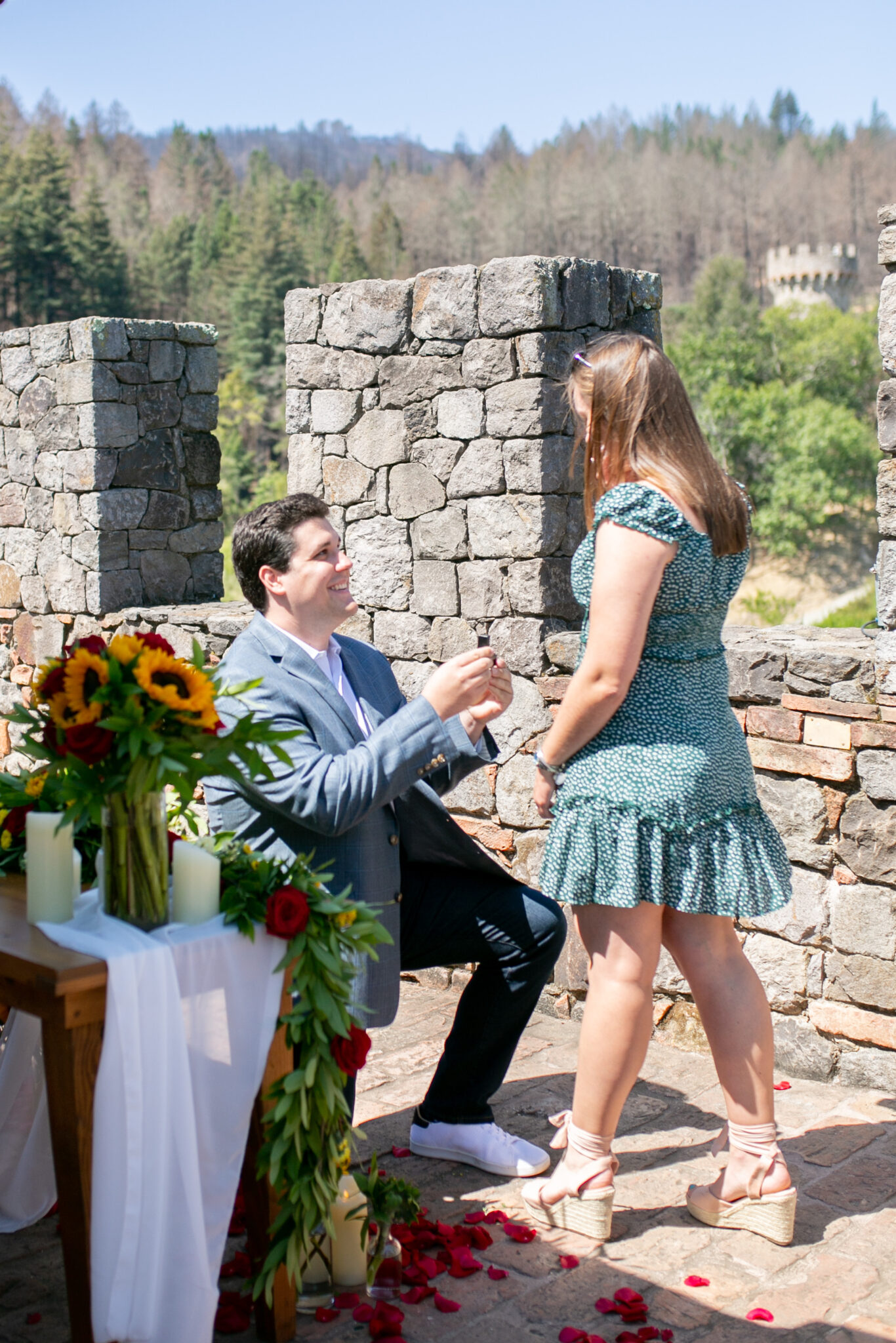 Man down on one knee for marriage proposal in Napa at a castle