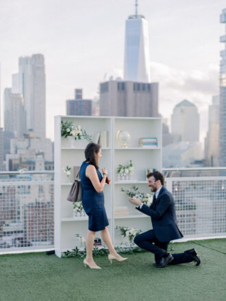 Man down on one knee for marriage proposal in new york