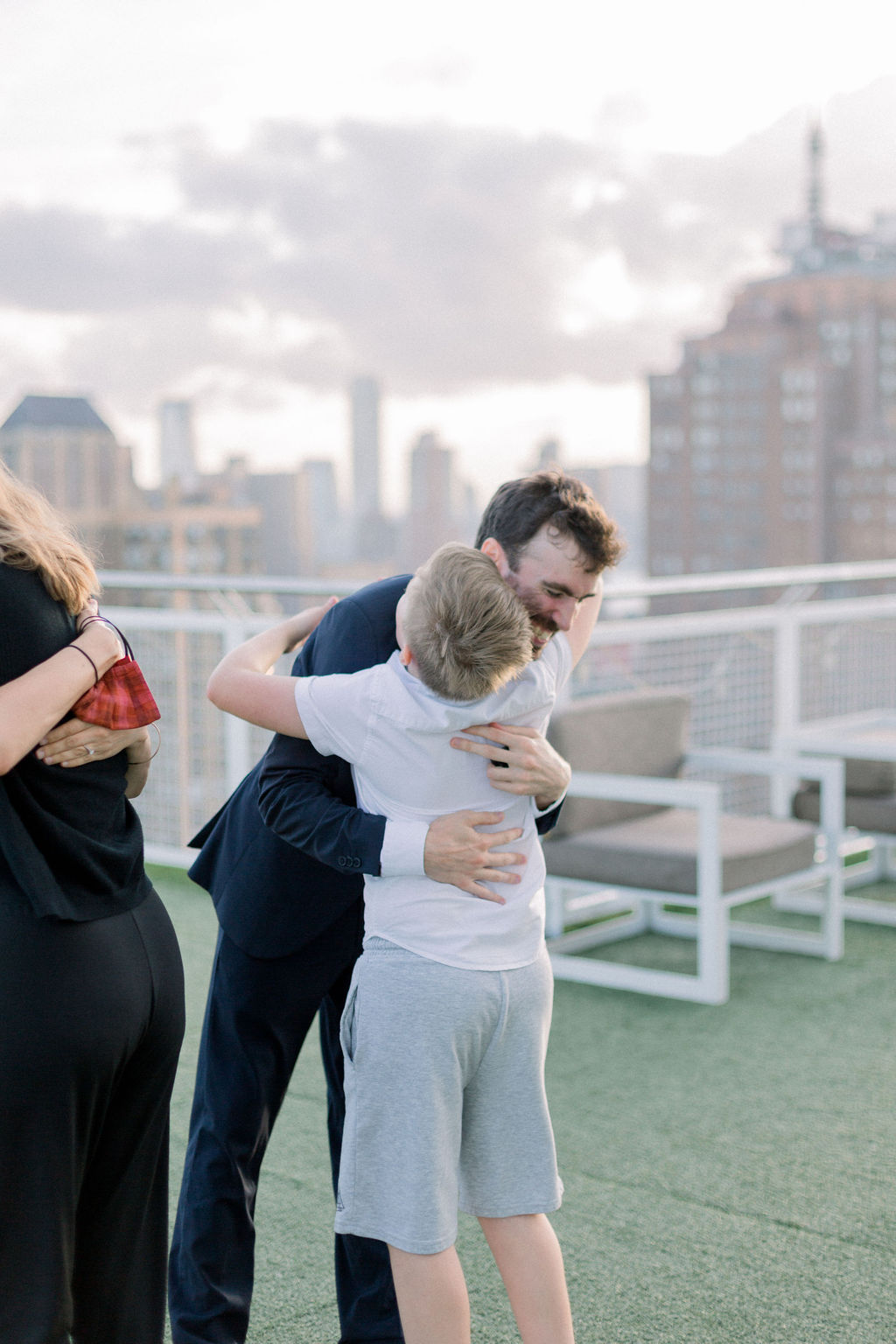 man embracing family at marriage proposal