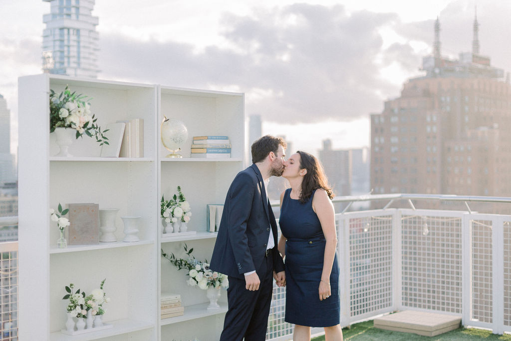 newly engaged couple kissing in new york