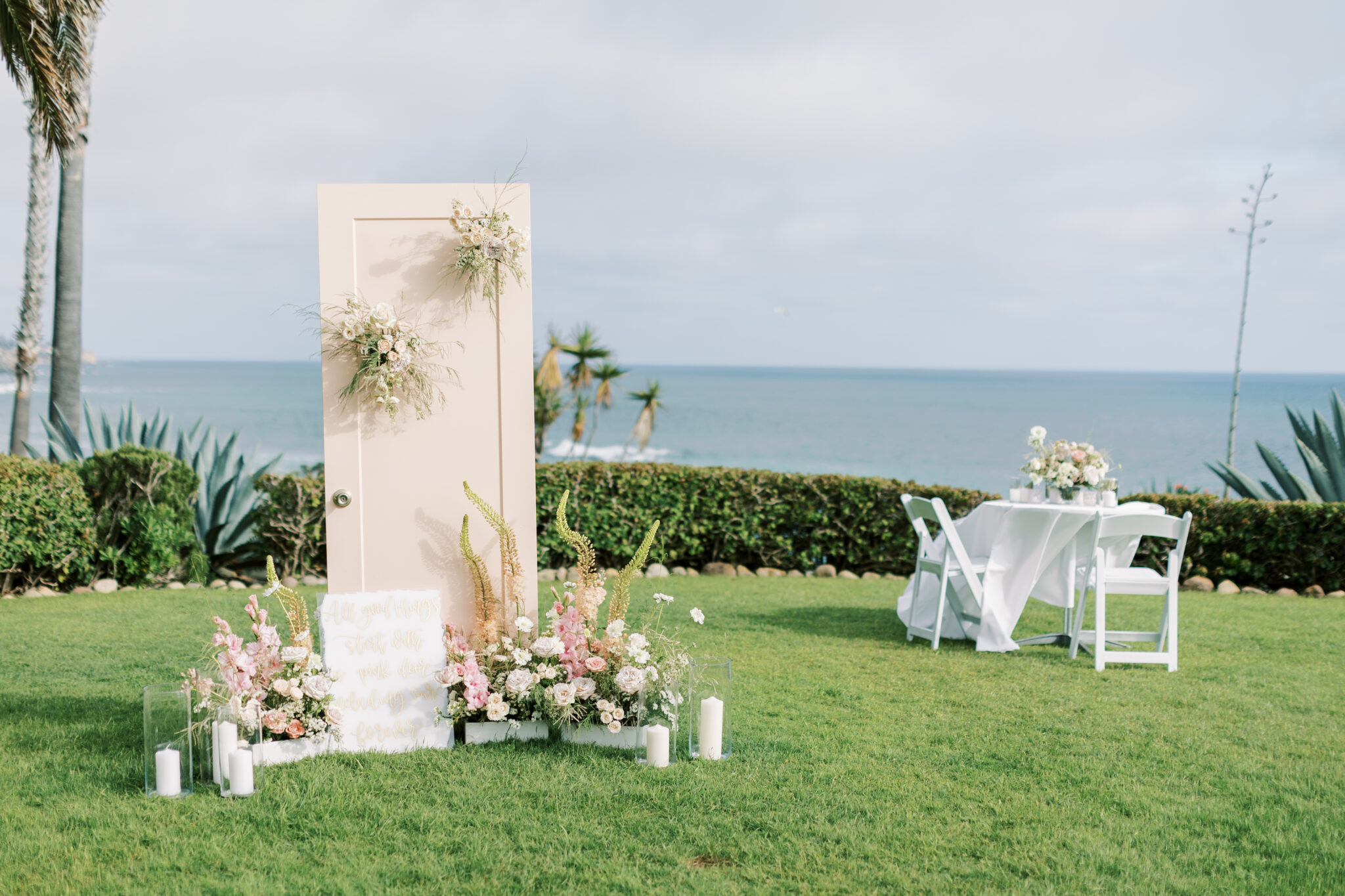 Marriage proposal pink door set up in laguna beach