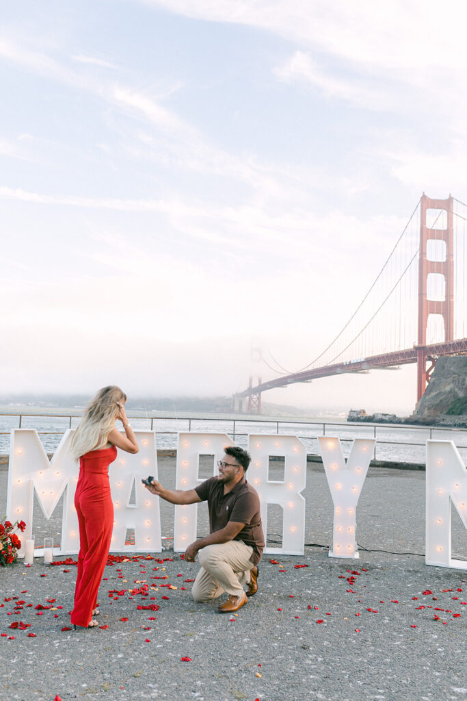 Man proposing in front of Golden Gate Bridge