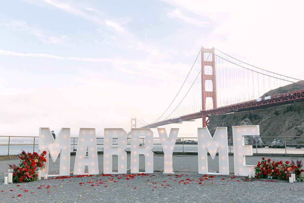 Marry Me sign in front of golden gate bridge