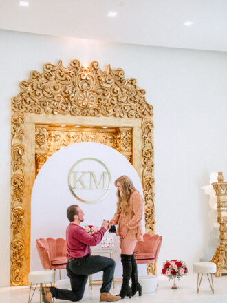 Man Proposing in front of backdrop